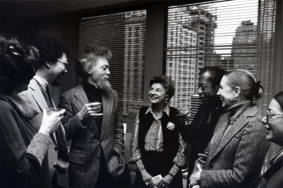 Benny Andrews (center), with brother Raymond Andrews (left) and James Baldwin (right), celebrating the awarding of the first James Baldwin Prize for Fiction to Raymond's *Appalachee Red* (1977), Dial Press headquarters, New York, 1979.