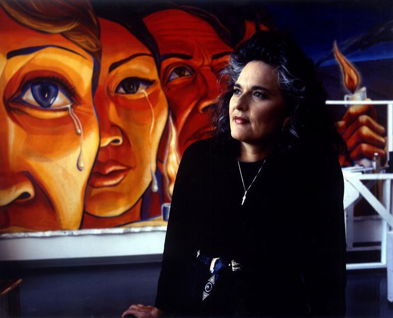 Portrait of Judy Baca with *Triumph of the Hearts*, 1990. Acrylic on canvas, one of nine panels: each 10 x 30 feet.