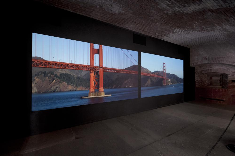 a two screen projected image of the Golden Gate Bridge